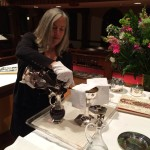 Mary Rosenberger Pours Wine For Communion