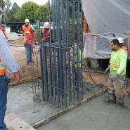 Concrete, Steel Cages Installed Deep Under New Tower Location